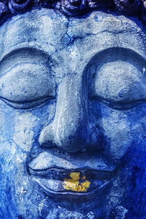 buddah: Buddha face with golden and blue. Stock Photo