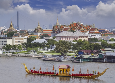 bangkok city: Landscape of Thais king palace with goldent guard ship on the front.