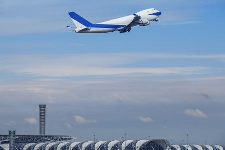 strips away: white passenger plane is landing away from airport
