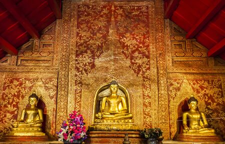 buddha image: CHIANGMAI THAILAND - OCTOBER 25   The Main Buddha with golden Thai pattern backgroung in the Wat sing temple, Thailand on October 25, 2012