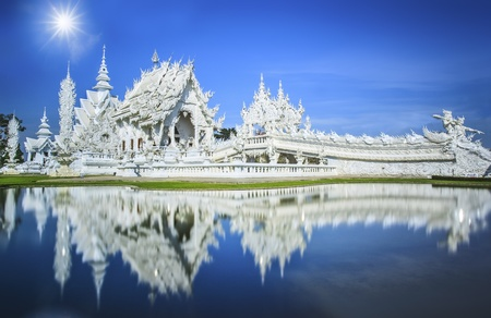 Magnificently grand white church and reflection in the water, Rong Khun temple, Chiang Rai province, northern Thailand photo