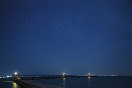 pp: Space on the background with star, sea and wooded bridge  Stock Photo
