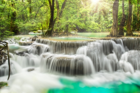 background waterfalls: Second level of Erawan Waterfall in Kanchanaburi Province, Thailand