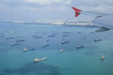 merchant: Cargo ships entering one of the busiest ports in the world, Singapore.