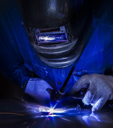 Worker welding the steel part by manual Stock Photo - 19294216