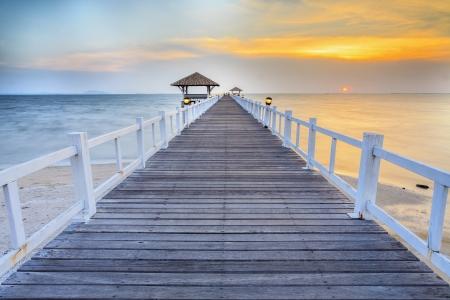 Vintage wooded bridge in the port between sunrise.