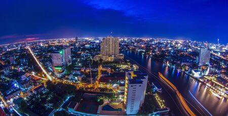 bird eye view: Bird eye view for Bangkok city with bueifull sunset and the river. Stock Photo