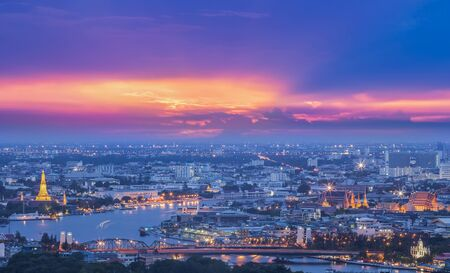 Bird eye view for Bangkok city with bueifull sunset and the river. photo