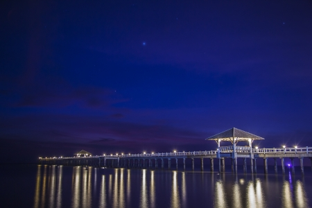 pp: Space on the background with star, sea and wooded bridge.