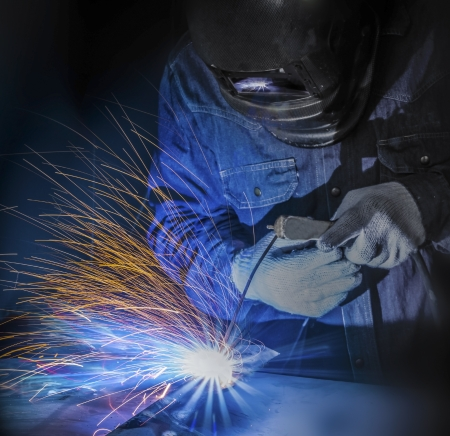 welding metal: Worker welding the steel part by manual