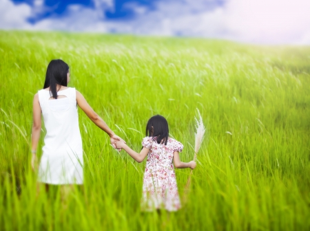 runing: Mom and daughter runing in nature background