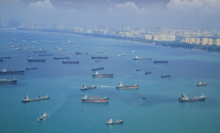 naval: Landscape from bird view of Cargo ships entering one of the busiest ports in the world, Singapore.