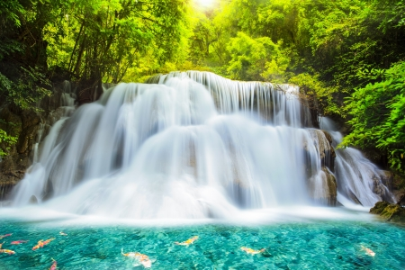 background waterfalls: Level three of Huai Mae Kamin Waterfall in Kanchanaburi Province, Thailand