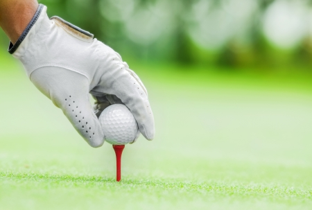 golf ball: Start game by put the golf ball Stock Photo