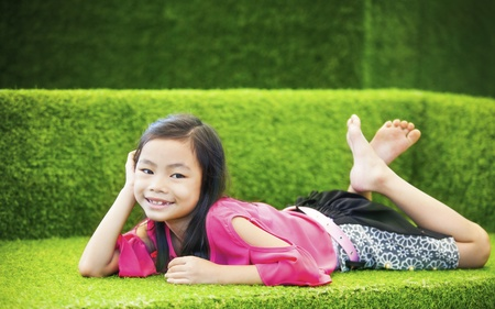 picknic: Baby girl taking relax on nature sofa