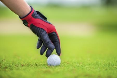 golf glove: Start game by put the golf ball Stock Photo