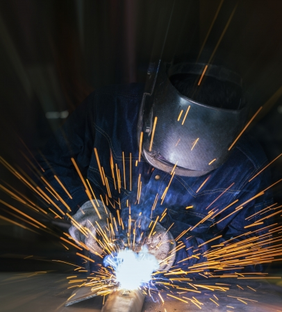 skilled: Worker welding the steel part by manual Stock Photo