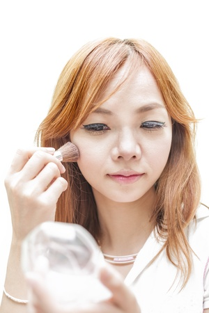 Beauty woman make up with brush photo
