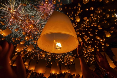 Thai people floating lamp in Yeepeng festival photo