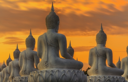 sukhothai: Many Buddha statue on sunset Stock Photo