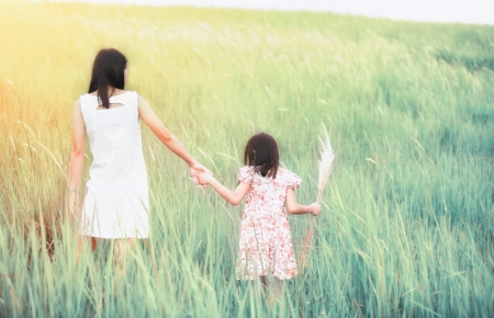 Mom and daughter runing in nature background photo