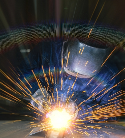 welding worker: Worker welding the steel part by manual Stock Photo