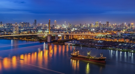 River in Bangkok city in night time with bird view Editorial
