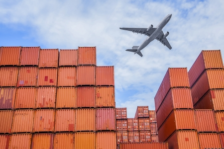 loading cargo: industrial port with containers and air Editorial