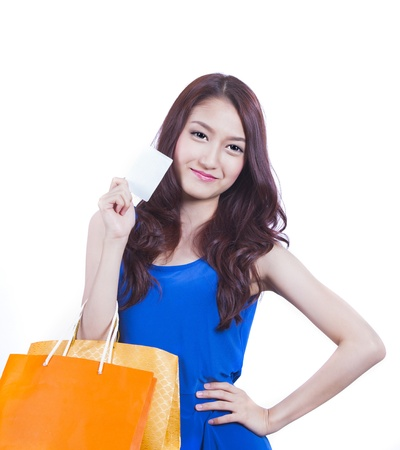 Shopping woman happy smiling holding shopping bags isolated on white background  with Asian Caucasian female model  photo