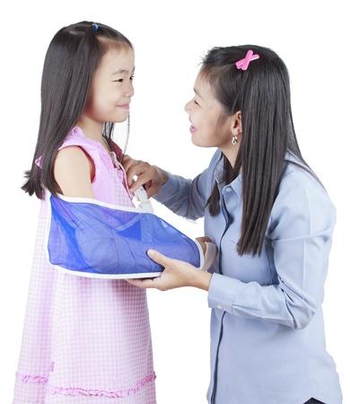 bandaged: Little baby girl showing her bandaged hand Stock Photo