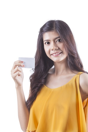 Shopping woman happy smiling holding card with white isolated background photo