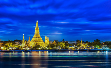 phraya: Wat arun and light from boat with blue sky , Thailand