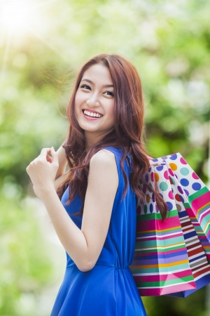 Smiling girl with shopping bags after shopping Stock Photo