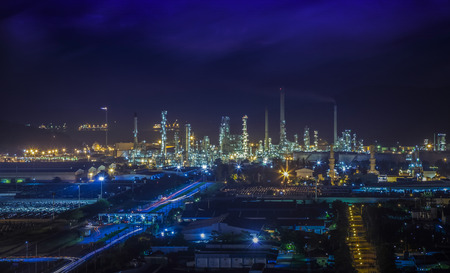 Landscape of oil refinery industry with oil storage tank and port photo