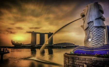 statue: Singapore landmark Merlion with sunrise