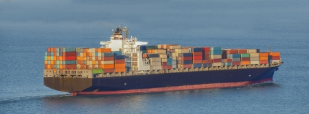 cargo container ship in mediterranean coast photo