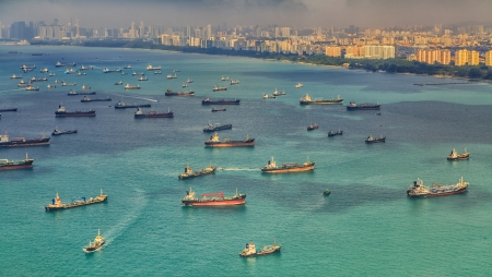 spill: Landscape from bird view of Cargo ships entering one of the busiest ports in the world, Singapore  Editorial