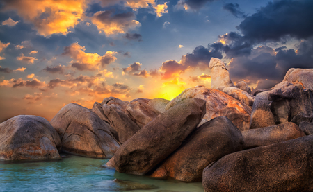 Samui: The Rock Hin ta from Thai island of Koh Samui  The picturesque pile of rocks on the beach, illuminated by the sunrise Stock Photo