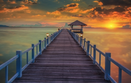 Wooded bridge in the port between sunrise at pattaya beach Thailand  photo