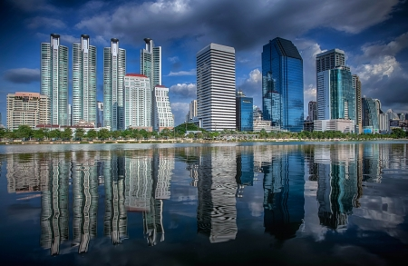 work area: Bangkok city downtown at day time with reflection of skyline, Bangkok,Thailand Stock Photo