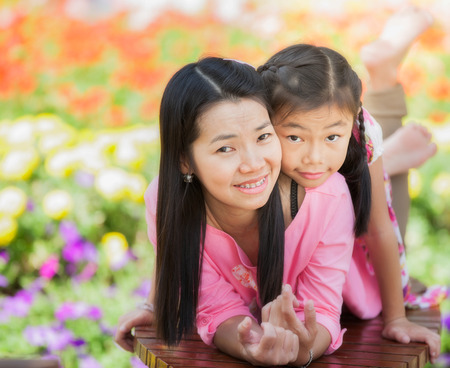 Asian little girl and  mother in cosmos garden, Outdoor Portrait family photo