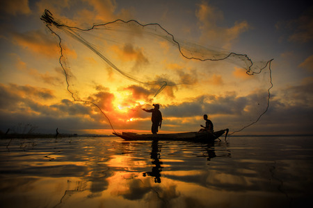 net fishing: Fisherman of Bangpra Lake in action when fishing, Thailand