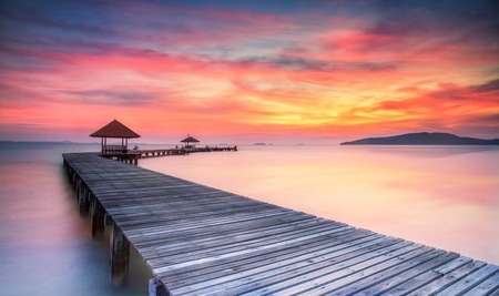 Wooded bridge in the port between sunrise. photo