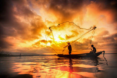 myanmar: Fisherman of Bangpra Lake in action when fishing, Thailand