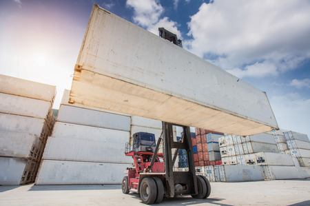 dockside: Crane lifter handling container box loading to truck