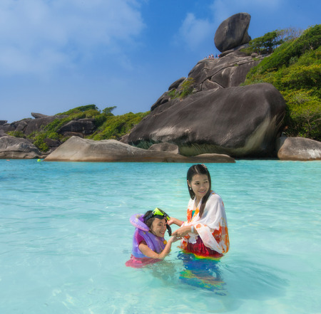 phangnga: Asia mother and her daughter in Tropical beach, Similan Island, Andaman Sea, Thailand