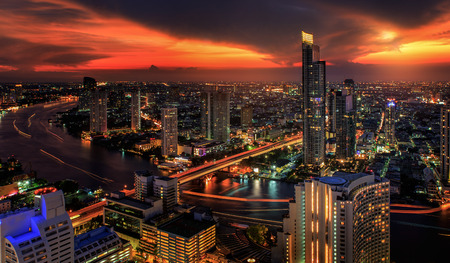 River in Bangkok city in night time with bird view photo