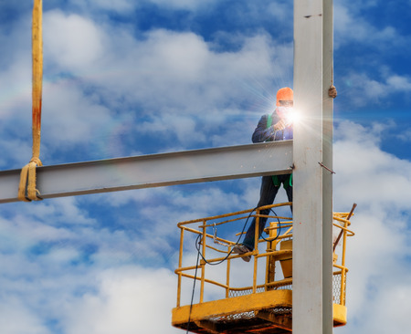 lifter: Workers welded steel structures with lifter and hight area Stock Photo