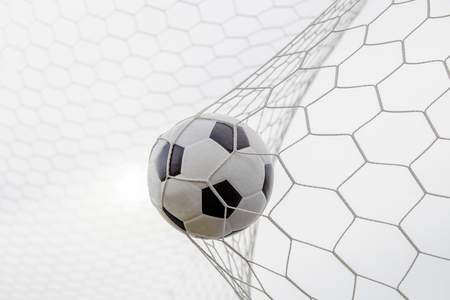 oal: soccer ball in goal with blue sky Stock Photo