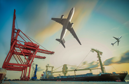 Boat and air plain for in background of Container Cargo freight ship with working crane loading bridge in shipyard at dusk for Logistic Import Export background photo